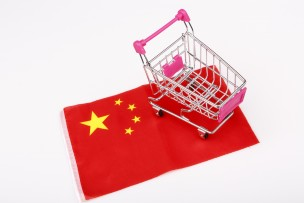 ping shopping cart on China flag - buying in china concept