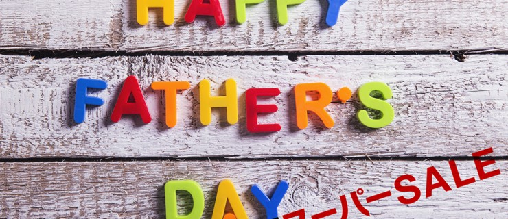 Colorful Happy fathers day sign on a white wooden background.