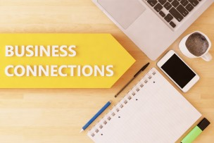 Business Connections - linear text arrow concept with notebook, smartphone, pens and coffee mug on desktop - 3d render illustration.