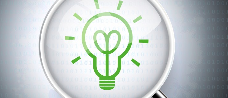magnifying glass with light bulb icon on digital background
