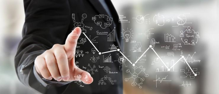Business man pressing high tech type of modern graph
